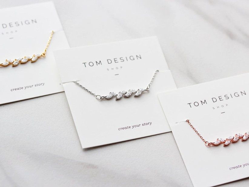 Minimalist crystal vine bracelets in yellow gold, silver, and rose gold