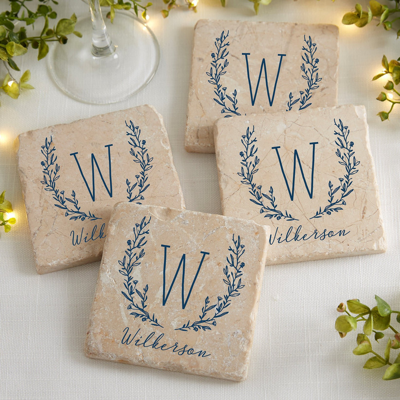 Rustic stone coasters with couple's monogram and last name