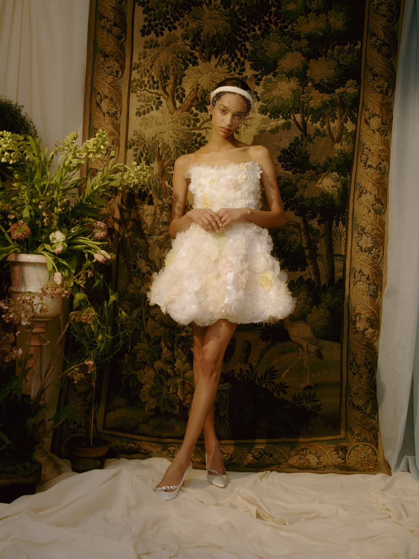 short strapless wedding dress with 3D floral embellishments and ruffles