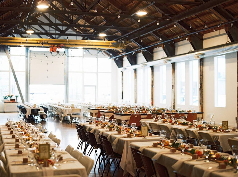 indoor wedding reception in industrial space with large windows