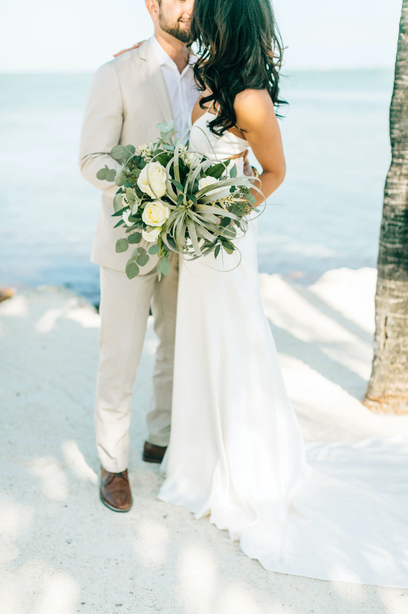 modern beach wedding bouquet with white roses greenery and large air plant