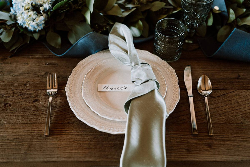 wedding place setting with silver satin napkin