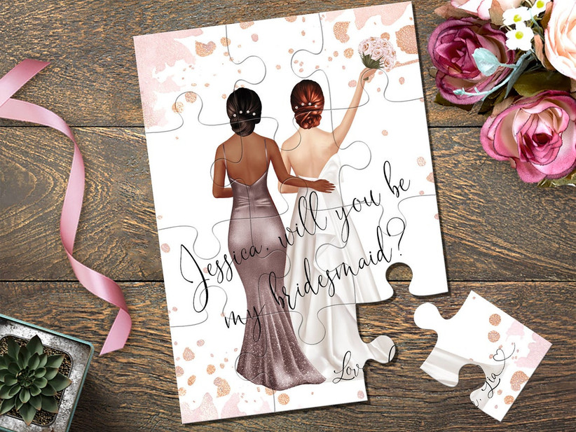 12-piece puzzle with custom illustration of a bride and her bridesmaid that reads Will You Be My Bridesmaid when put together