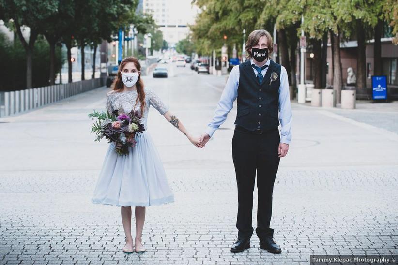 couple wearing wedding masks