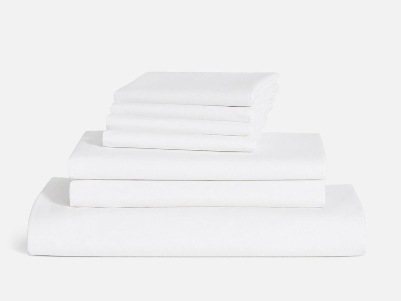 Stack of white bed linen from Brooklinen