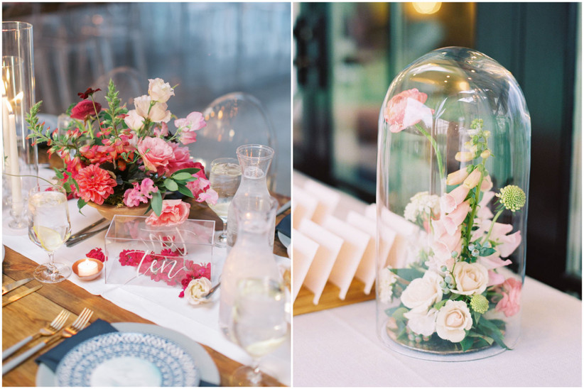 flowers are displayed in acrylic boxes as table numbers and inside a glass bell jar as trendy wedding centerpieces