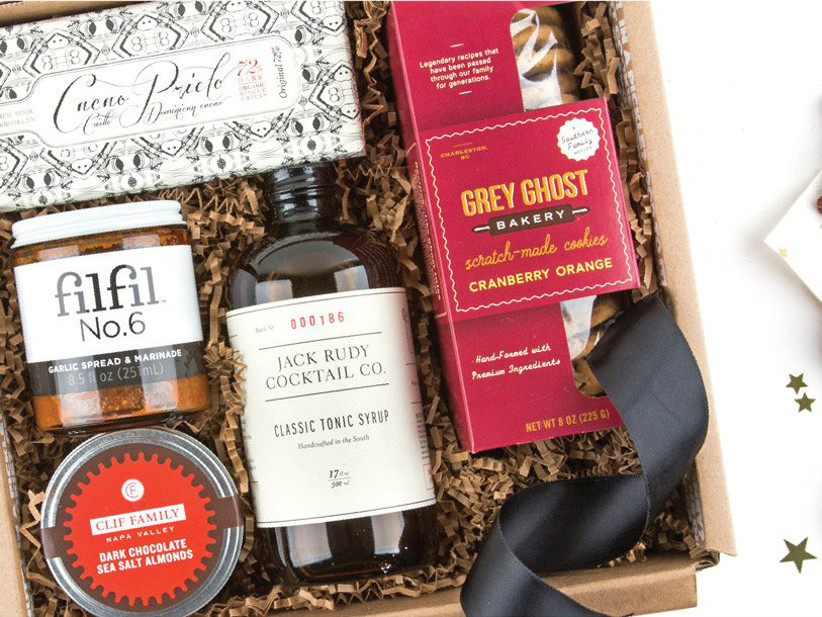 Mouth subscription gift box with a cocktail mixer, chocolate salted almonds, garlic spread, and cookie