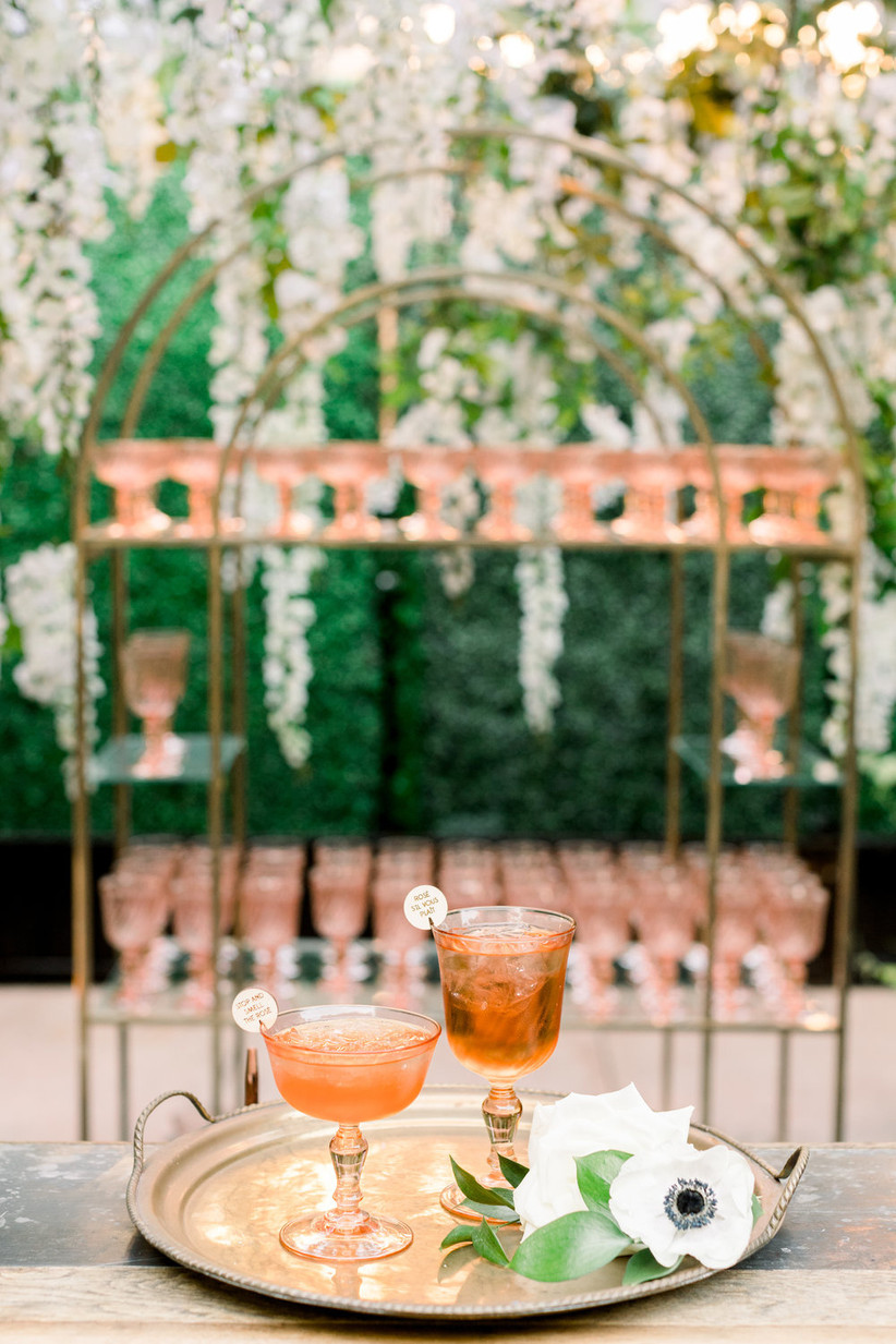 vintage champagne glasses with wooden drink charms that say