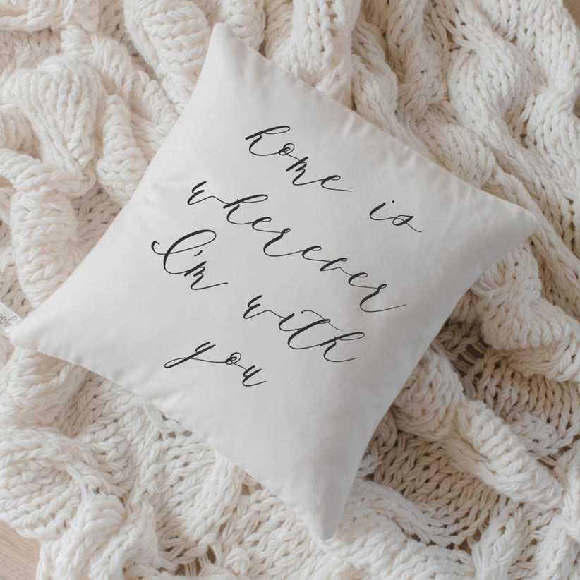 Pretty white cushion with black calligraphy stating Home is Wherever I'm With You
