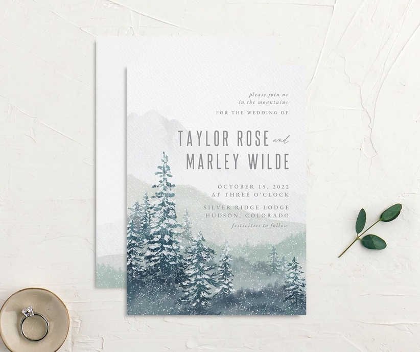Snowy forest and mountain scene affordable wedding invitation