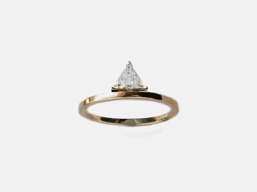 Unique trillion-cut diamond engagement ring on minimalist yellow gold band