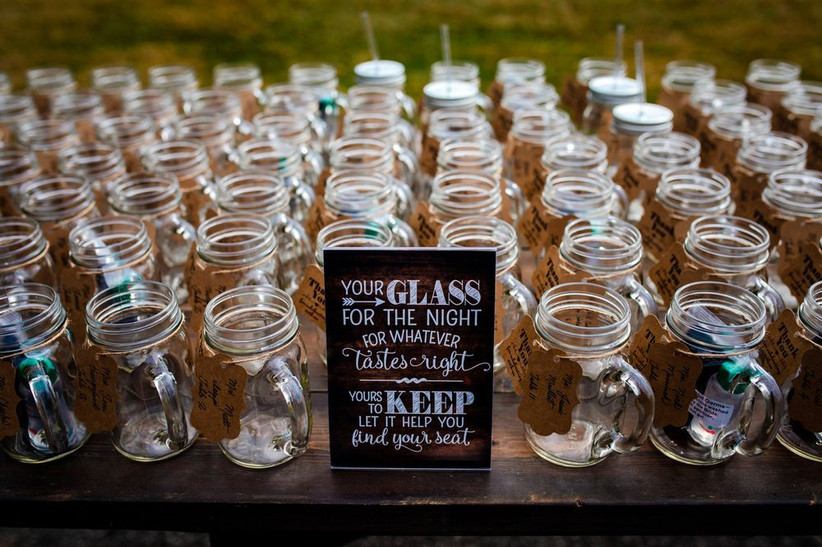 table of glass mason jar mugs with a sign that reads