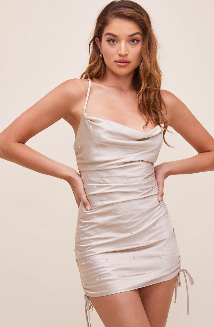 short bodycon bachelorette party dress blush pink dress with adjustable side ties and faux pearl embellishments allover