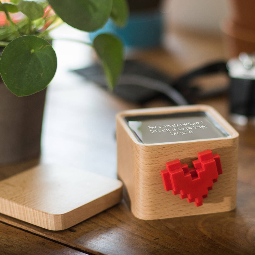 Small wooden box with spinning red heart on the front and message display on the top with lid