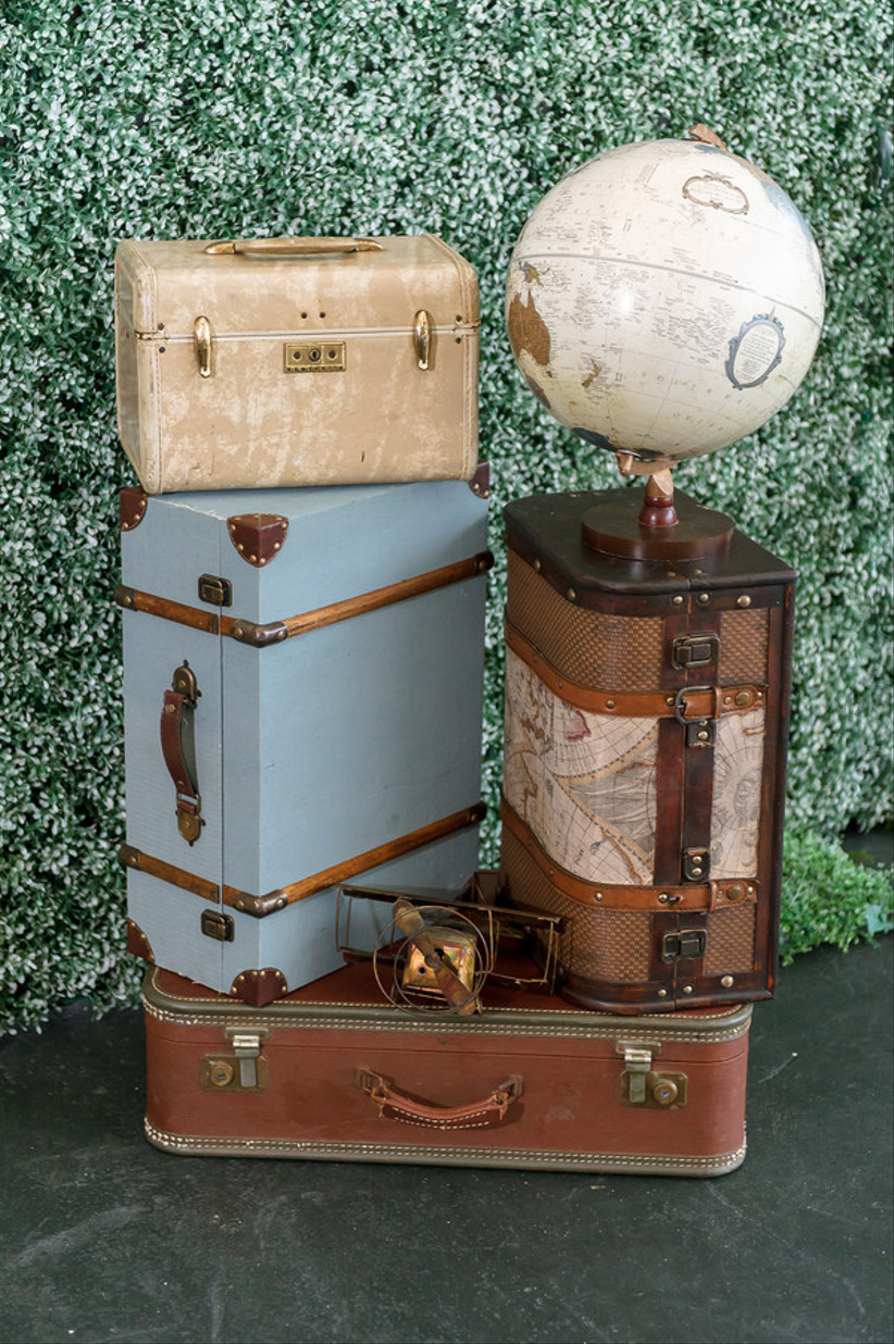 travel themed wedding decor stacks of vintage suitcases in different colors