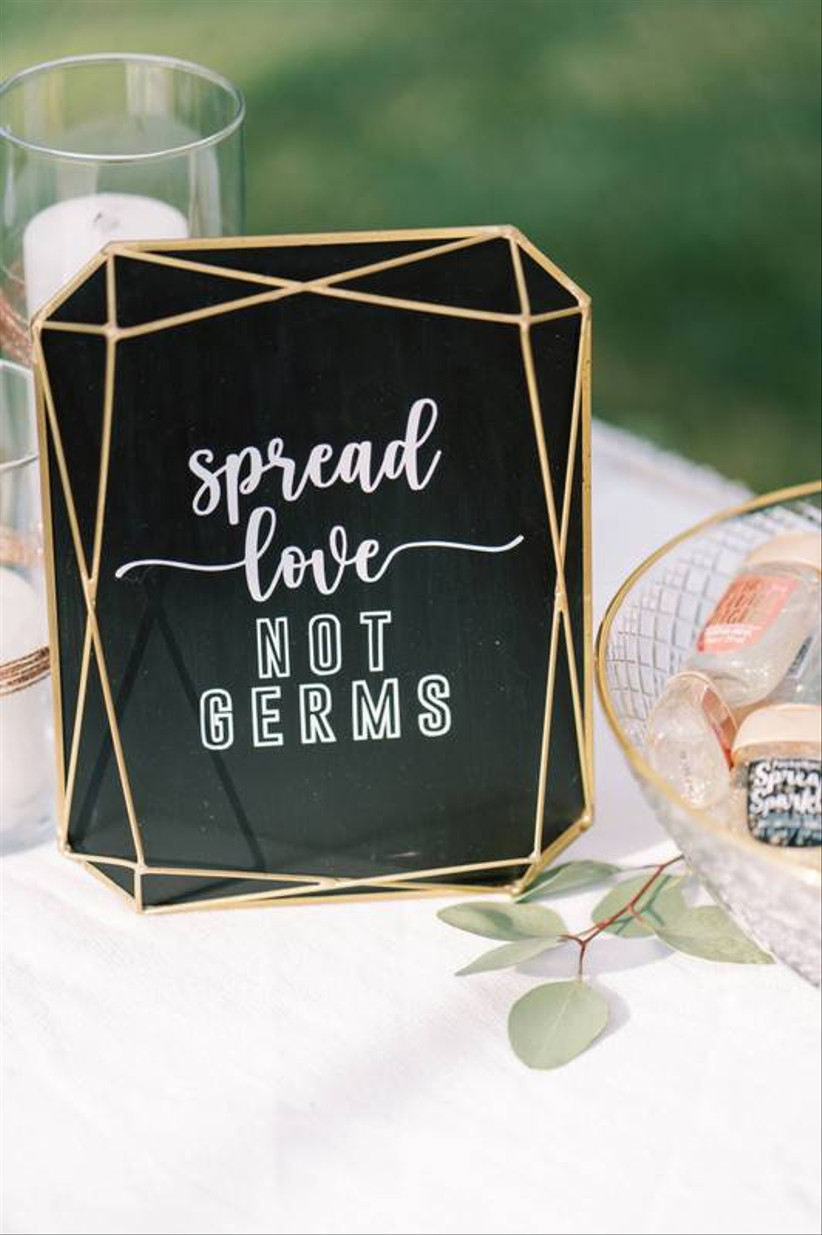 spread love not germs sign