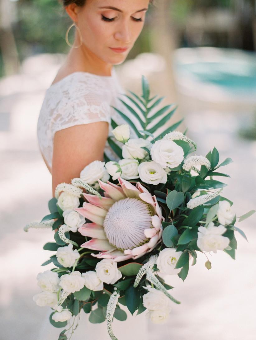 romantic protea bouquet with lisianthus, eucalyptus, ranunculus and gooseneck