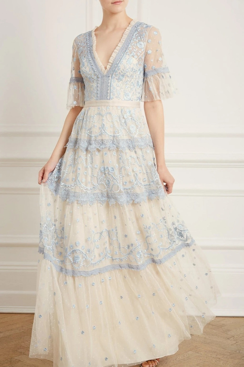 Model wearing vintage style embroidered white and pastel blue dress