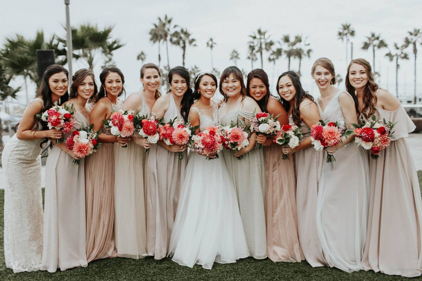 bride and bridesmaids wearing blush dresses and holding bright pink bouquets
