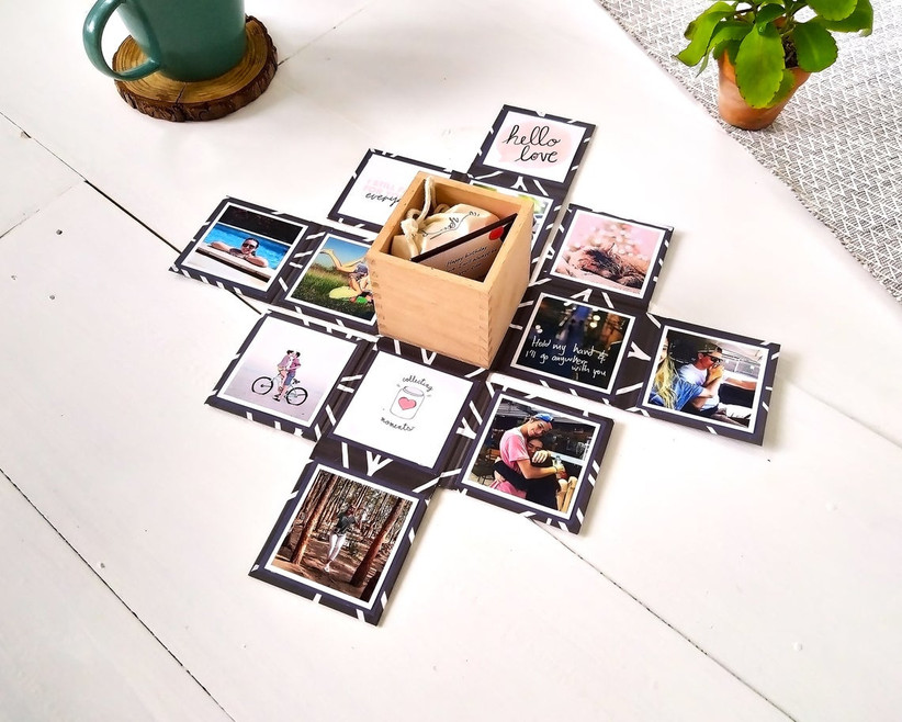 Small gift box that folds out to reveal tiny gift and magnetic photo display