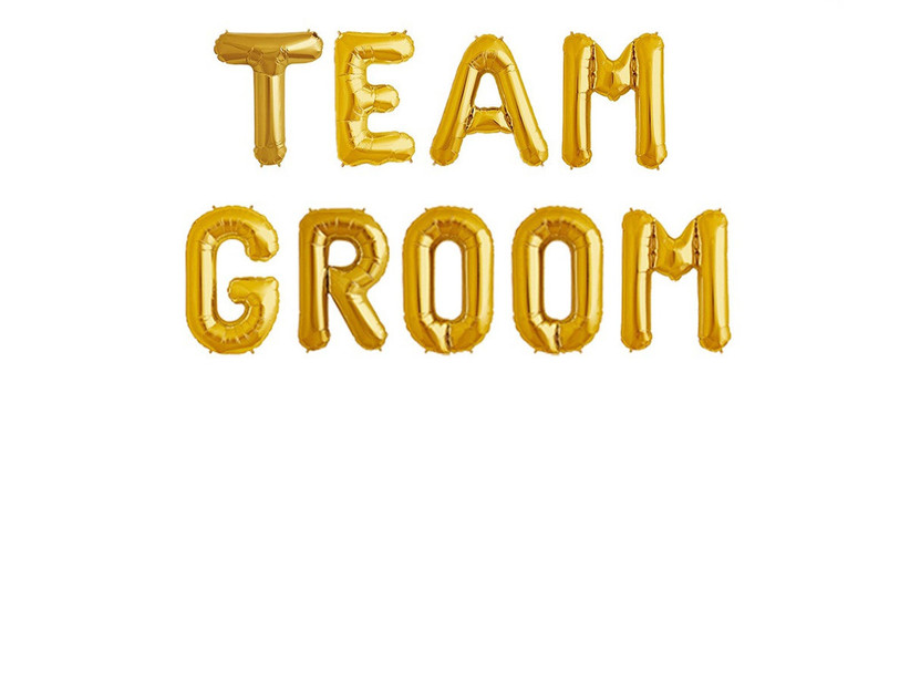gold balloons spelling out team groom