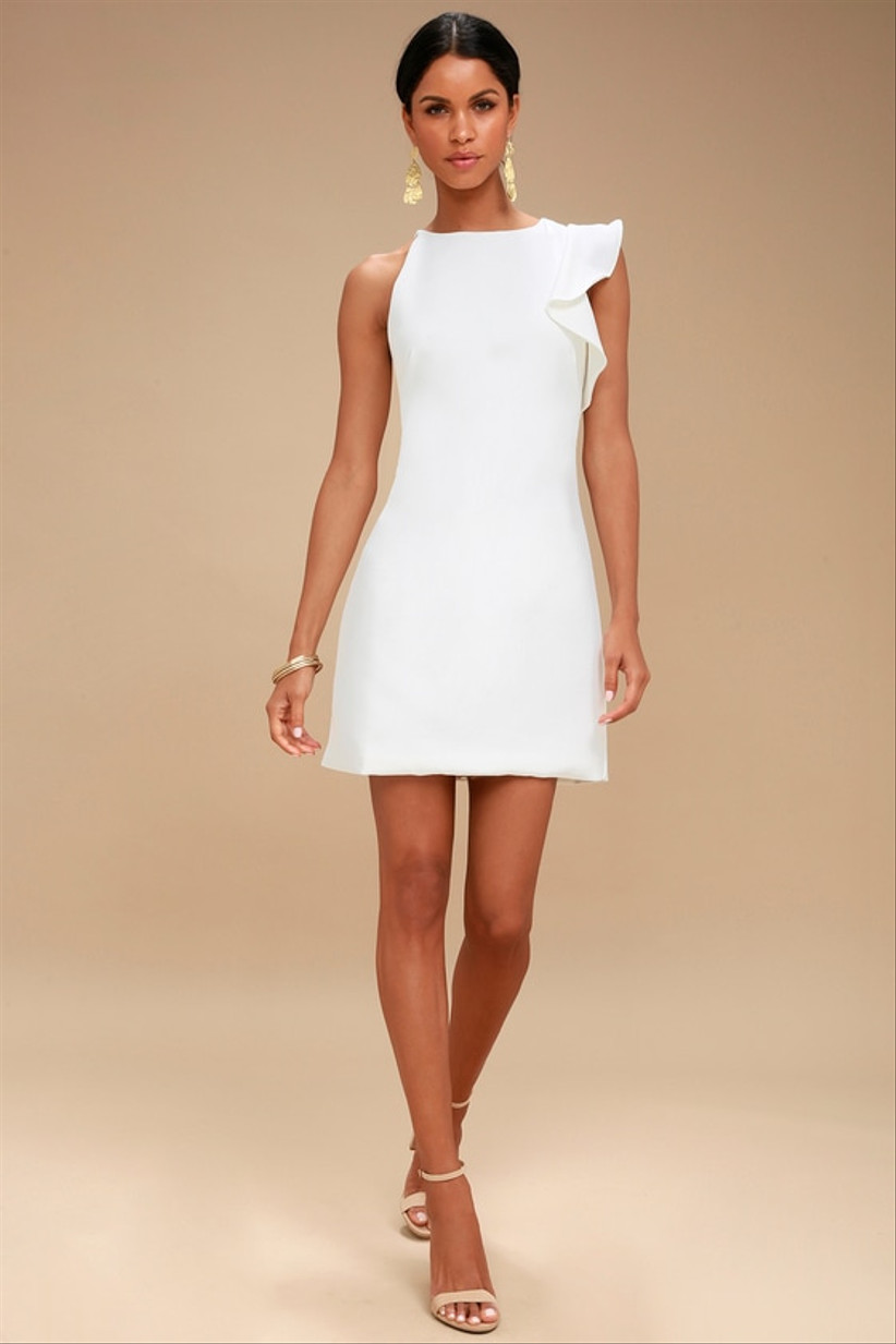short white engagement party dress shift silhouette with ruffle on one shoulder