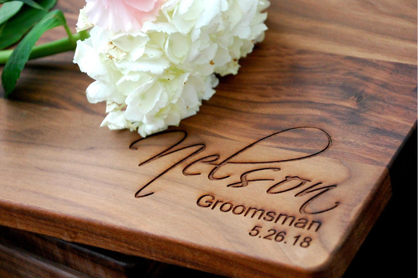 Cutting board engraved with groomsman name and wedding title