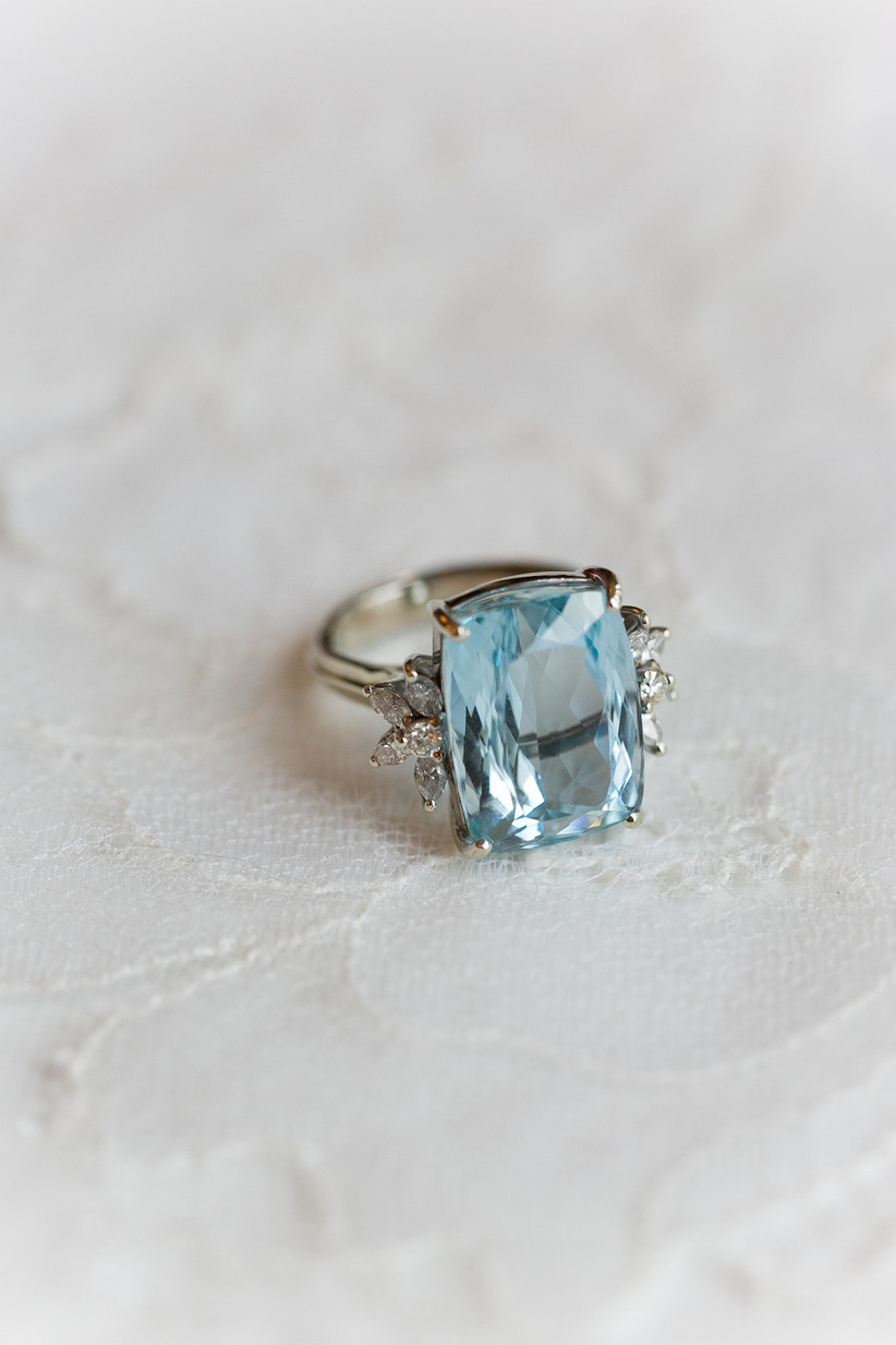 light blue aquamarine engagement ring trend cocktail ring with diamond accent stones and platinum setting