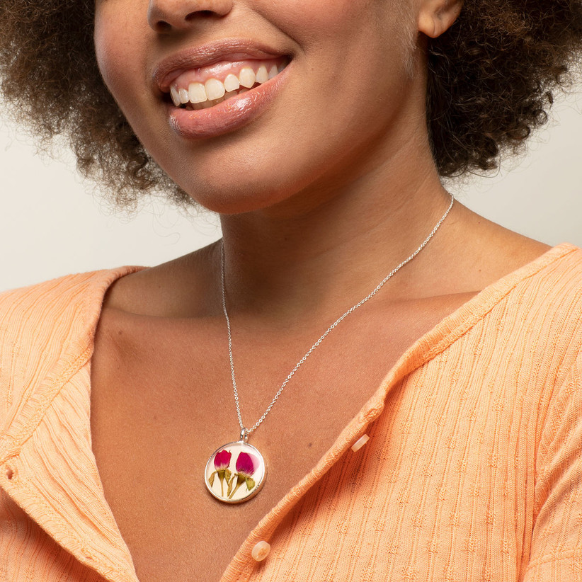 Woman wearing birth flower pendant necklace