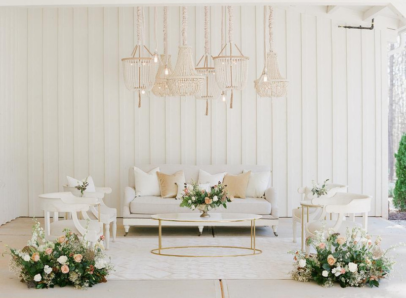 wedding reception lounge with beaded chandeliers hanging above