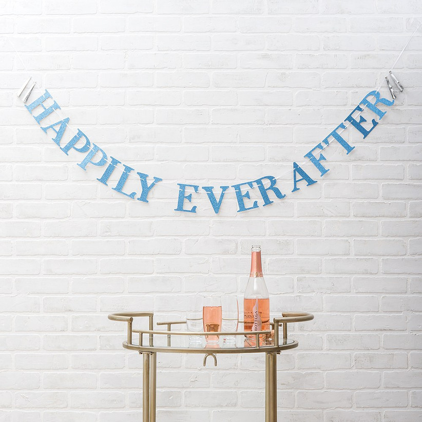 Glittery blue Happily Ever After banner over cocktail table
