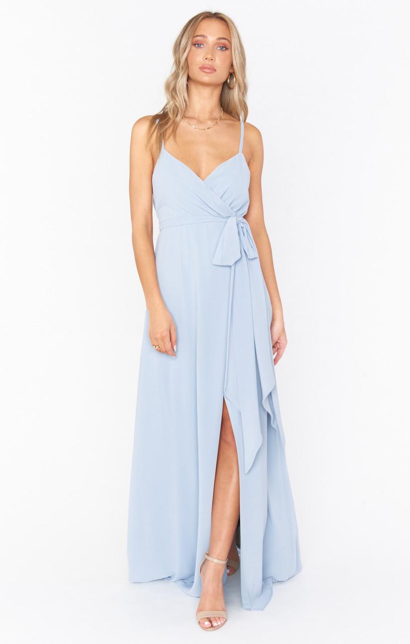 Model wearing illusion pastel blue wrap dress