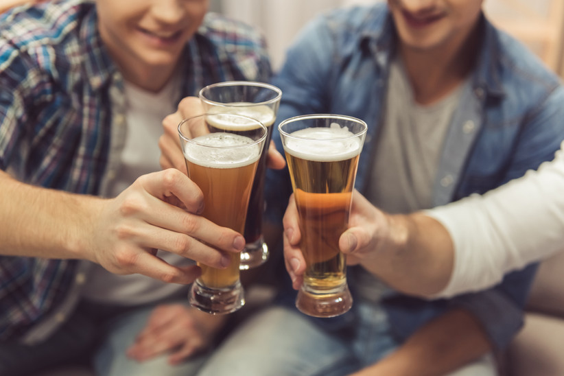 men toasting beers