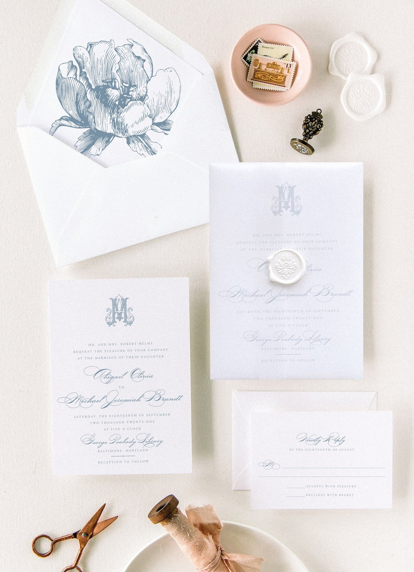 classic spring wedding invitation with light blue floral envelope liner and monogram