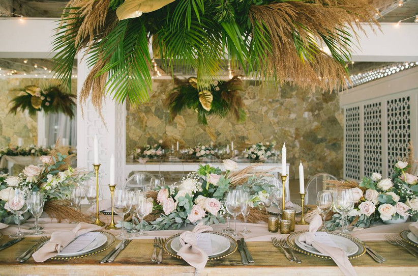 romantic beach wedding centerpiece with light pink roses and tropical greenery with pampas grass