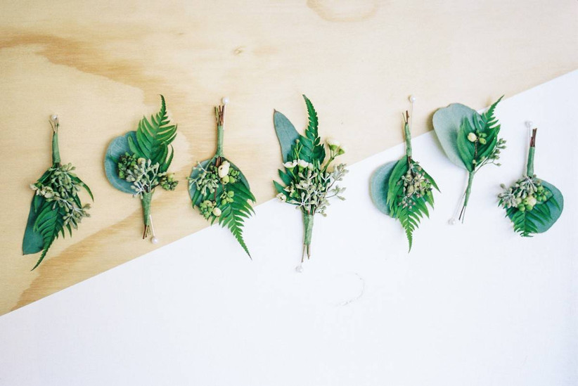 greenery wedding boutonnieres made with ferns and eucalyptus leaves