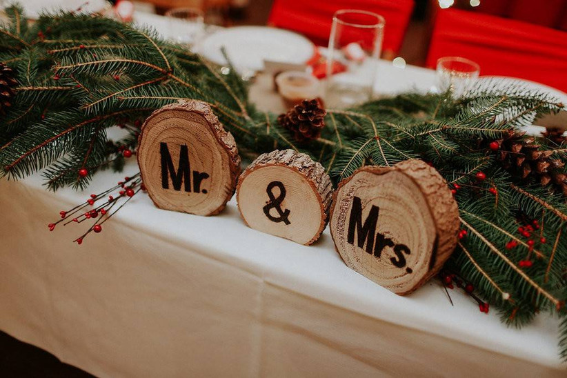 rustic winter wedding decor mr. & mrs. sign made from tree stumps