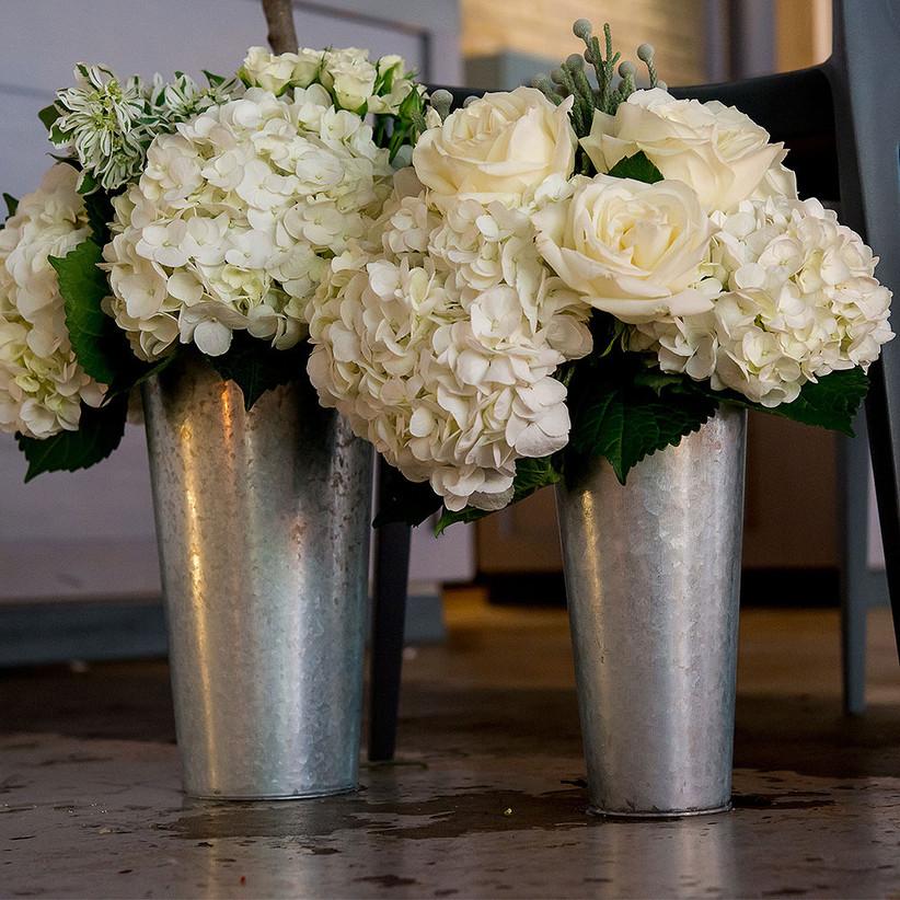 Market buckets full of gorgeous white flowers engagement party decoration idea