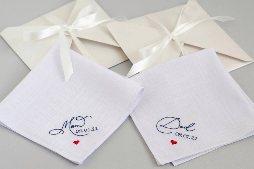 Two white handkerchiefs embroidered with Mom and Dad, the wedding date, and a red heart