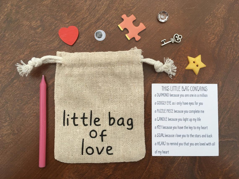 Burlap little bag of love with assorted contents displayed around it and an explanatory key