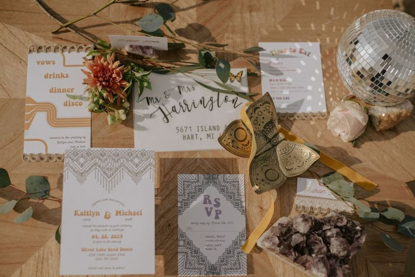 what to include in wedding invitations flat lay with disco ball