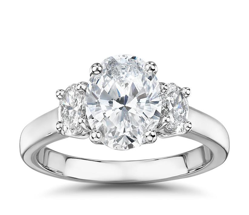 platinum three stone engagement ring with oval diamonds