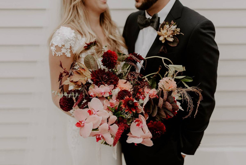 burgundy and pink fall wedding bouquet with orchids, eucalyptus and dahlias