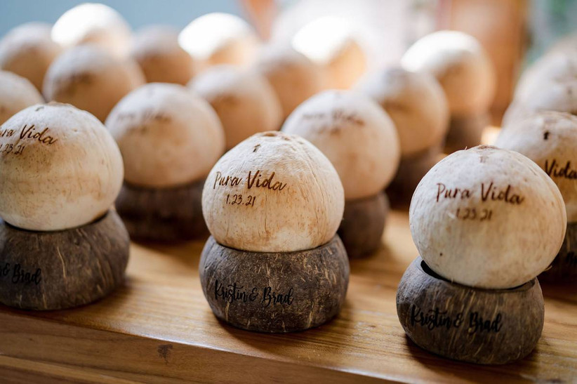 beach wedding escort cards coconuts engraved with guests' names