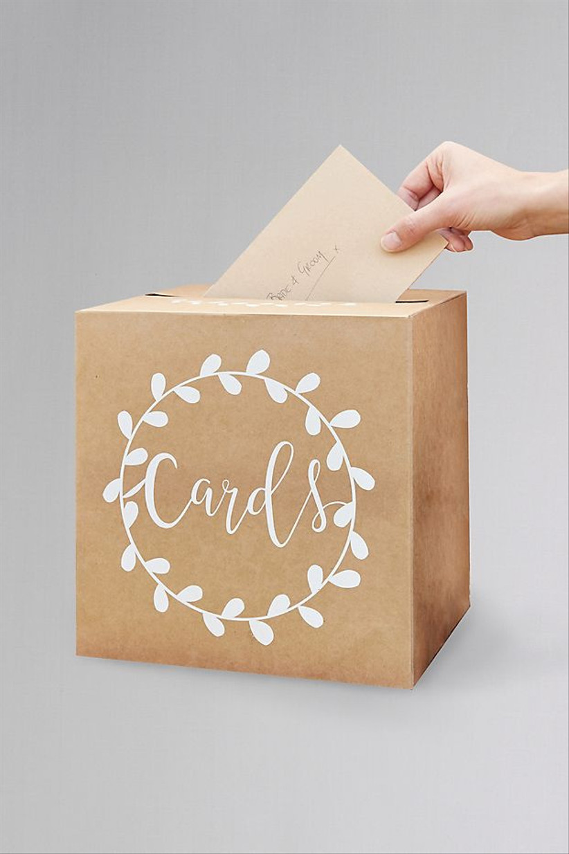 brown kraft paper wedding card box with the word cards in white calligraphy on the front