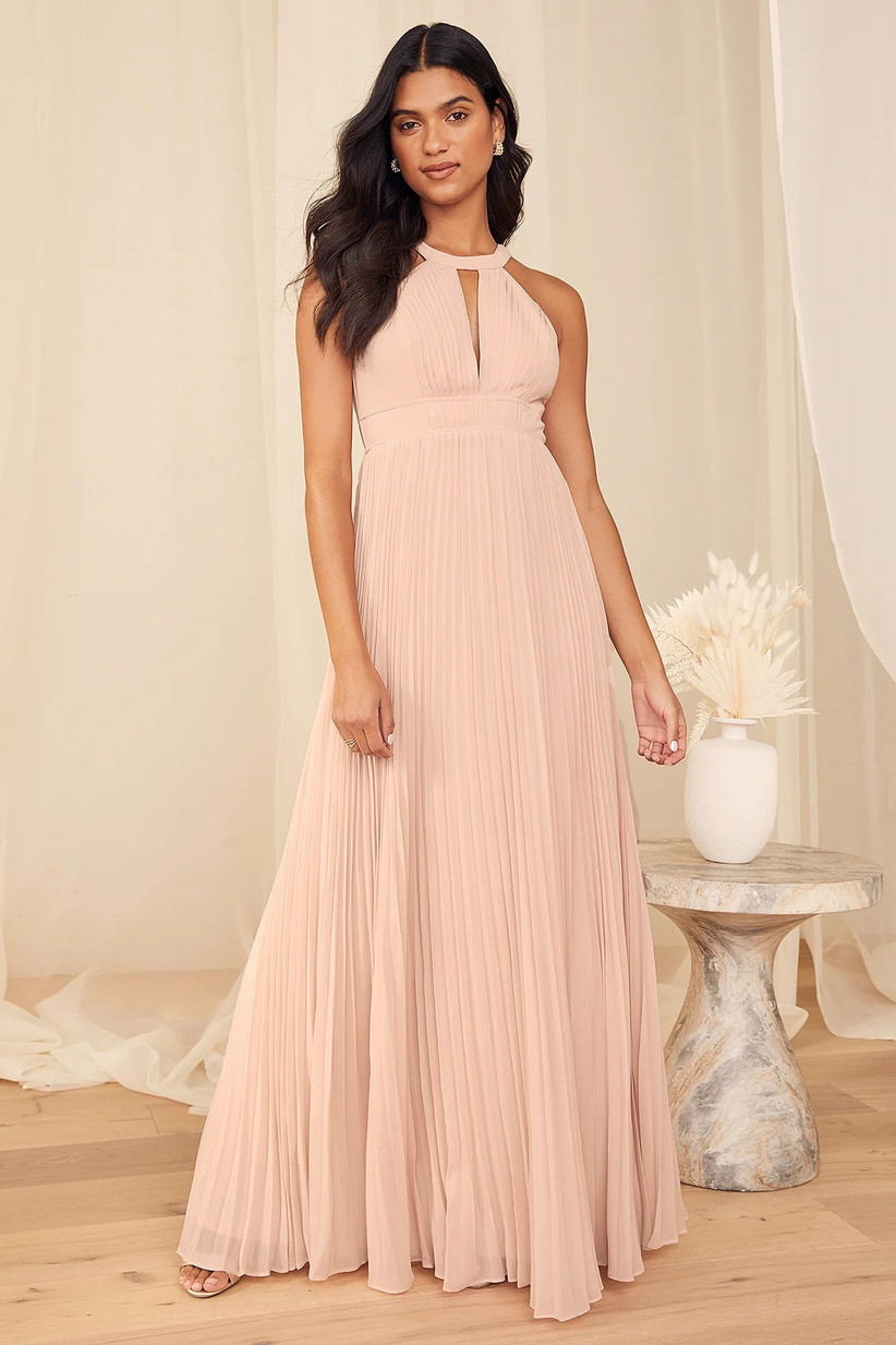 Model wearing pleated high neck pink pastel maxi with keyhole detail