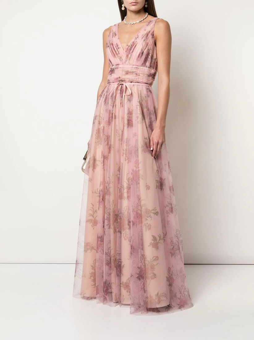 Model wearing sleeveless V-neck floral bridesmaid dress with pink tulle skirt