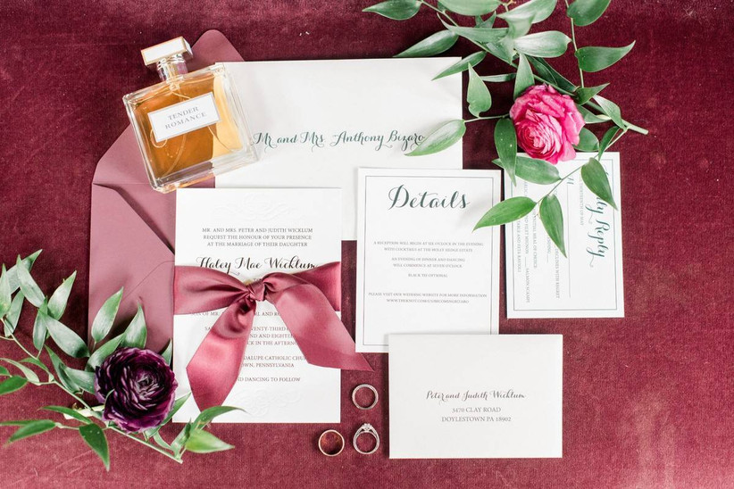 classic wedding invitations with red satin bow and burgundy envelope