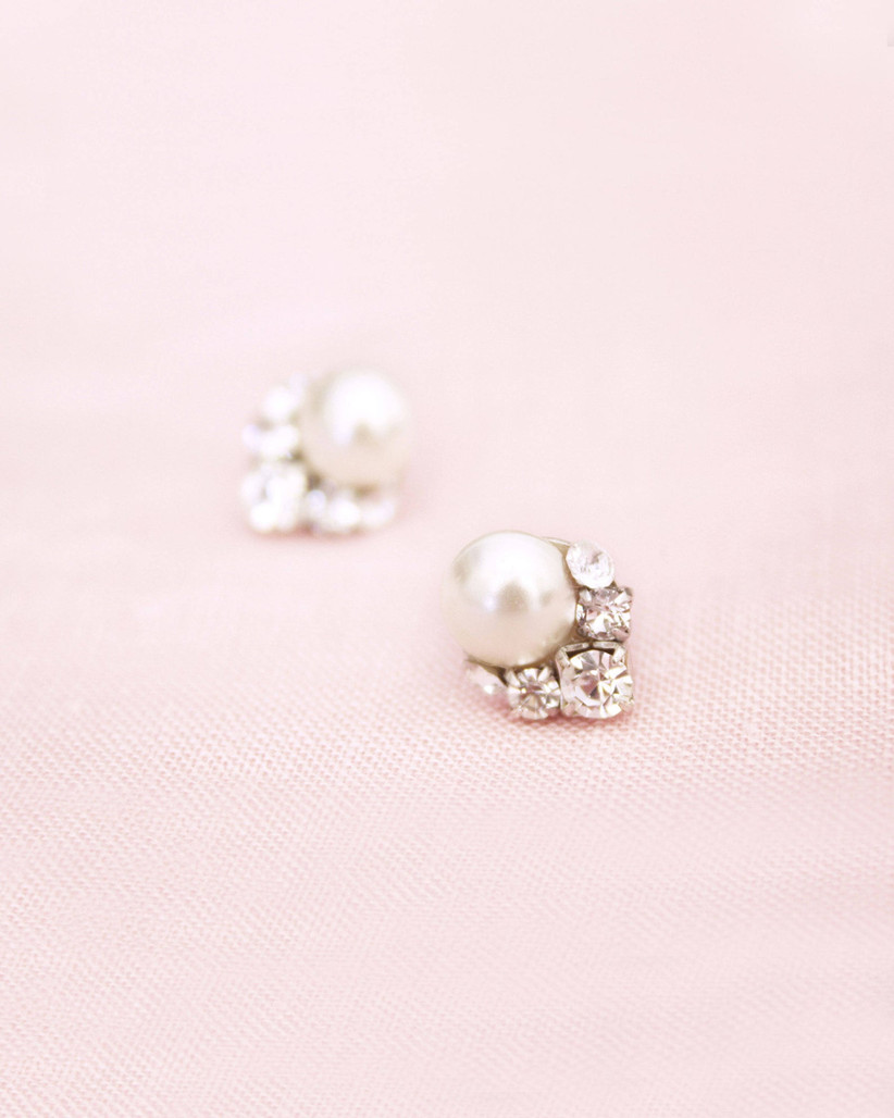 pearl and crystal cluster earrings on pink backdrop