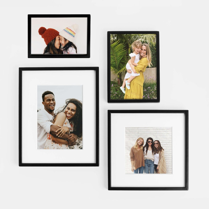 Selection of sentimental photos with friends and family in different sizes with black frames